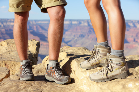 men's and women's pair of hiking footwear