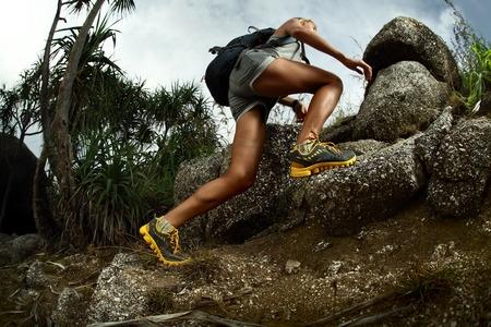 Woman Hiker on Rocky Terrain