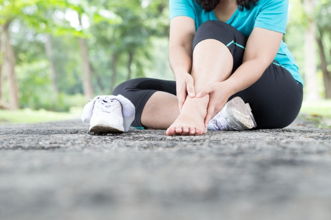 Woman Holding Ankle in Pain