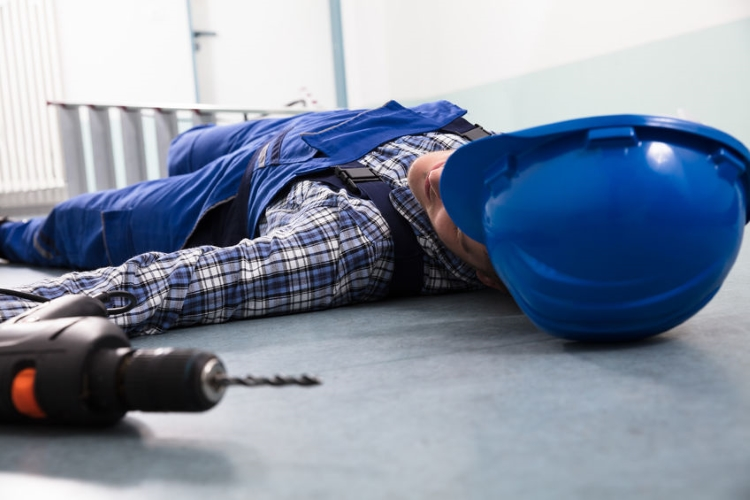Worker Fallen Down with drill