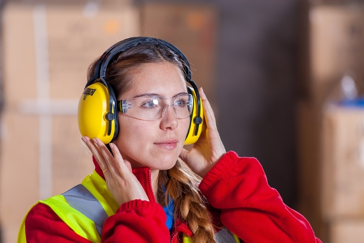 Worker With Safety Glasses and Ear Protection