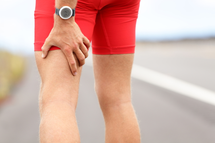 Man Holding Hamstring Muscle