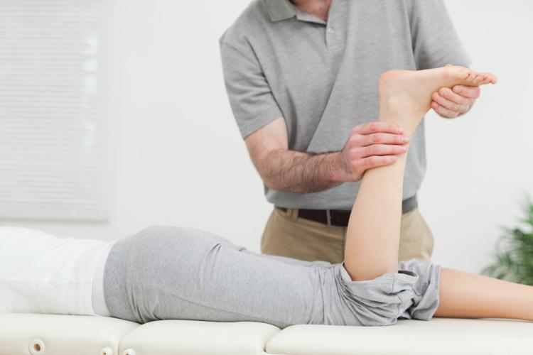 Physio Examining Painful Foot
