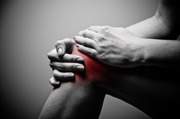 Clutching Knee in Pain