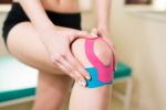 injured knee with kinesiotaping